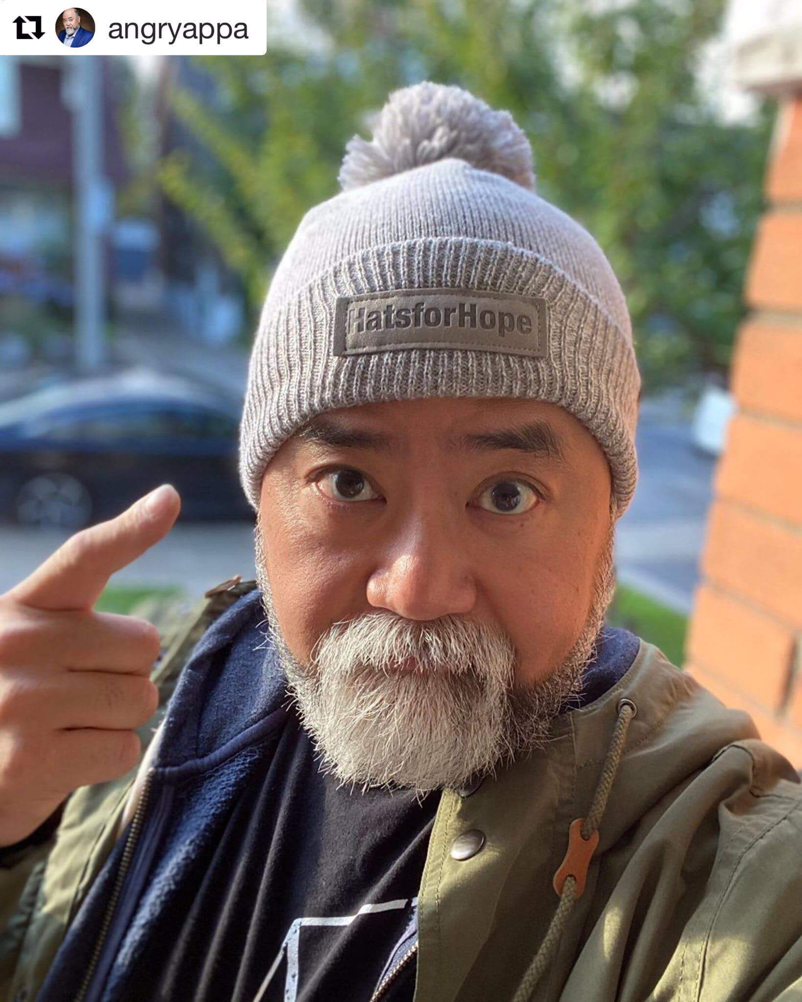 Actor Paul Sun-Hyung Lee (Kim's Convenience) wearing his Hats for Hope toque.