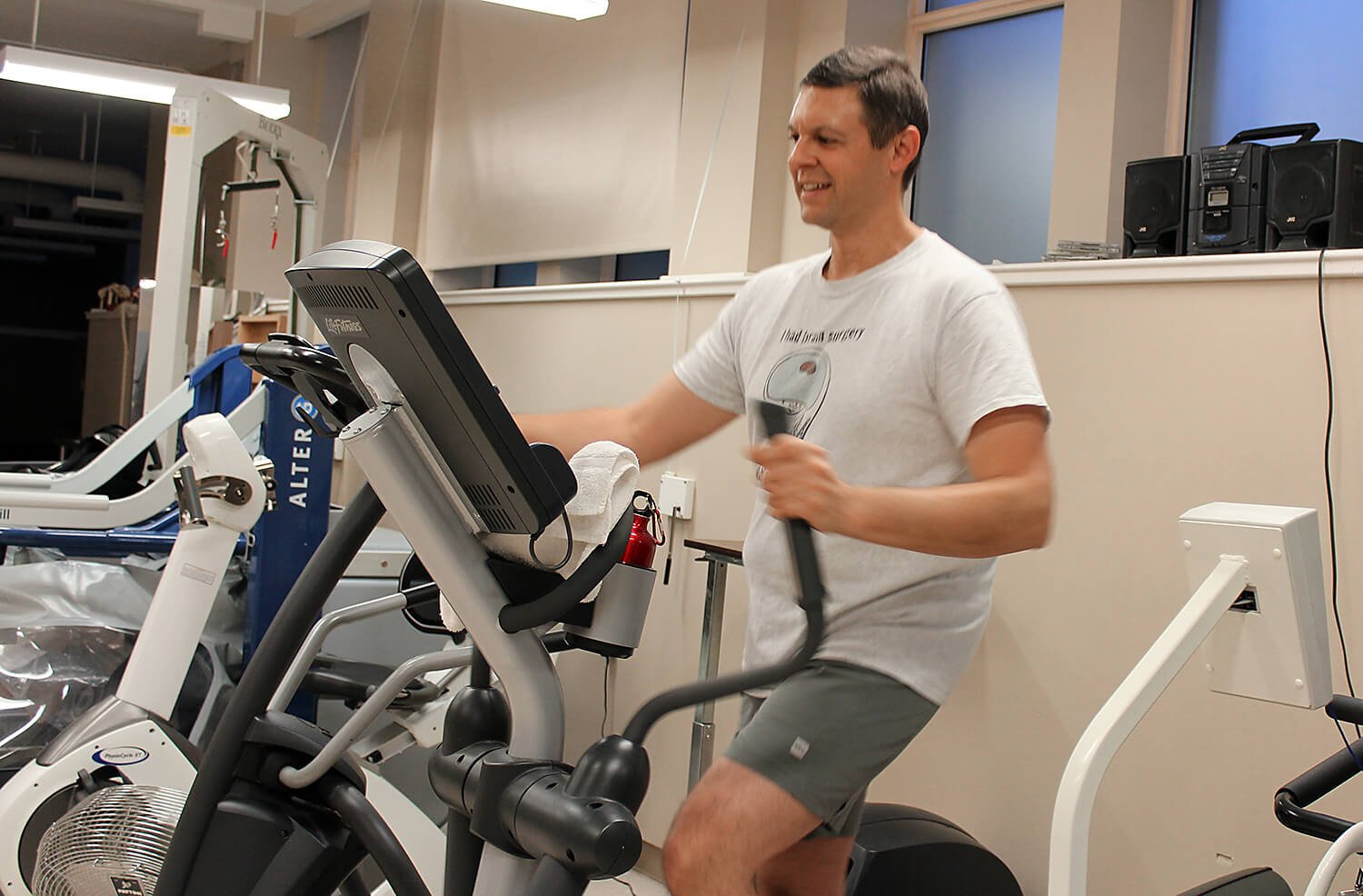 Cancer survivor, James, working out in a gym after surgery.